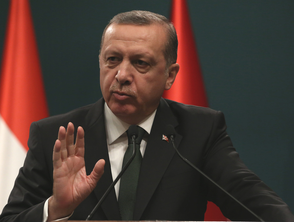 Turkish President Recep Tayyip Erdogan speaks to the media during a joint press conference with his Hungarian counterpart Janos Ader after their talks in Ankara, Turkey, Thurday, March 12, 2015. Ader is in Turkey for a state visit. AP Photo/Burhan Ozbilici)